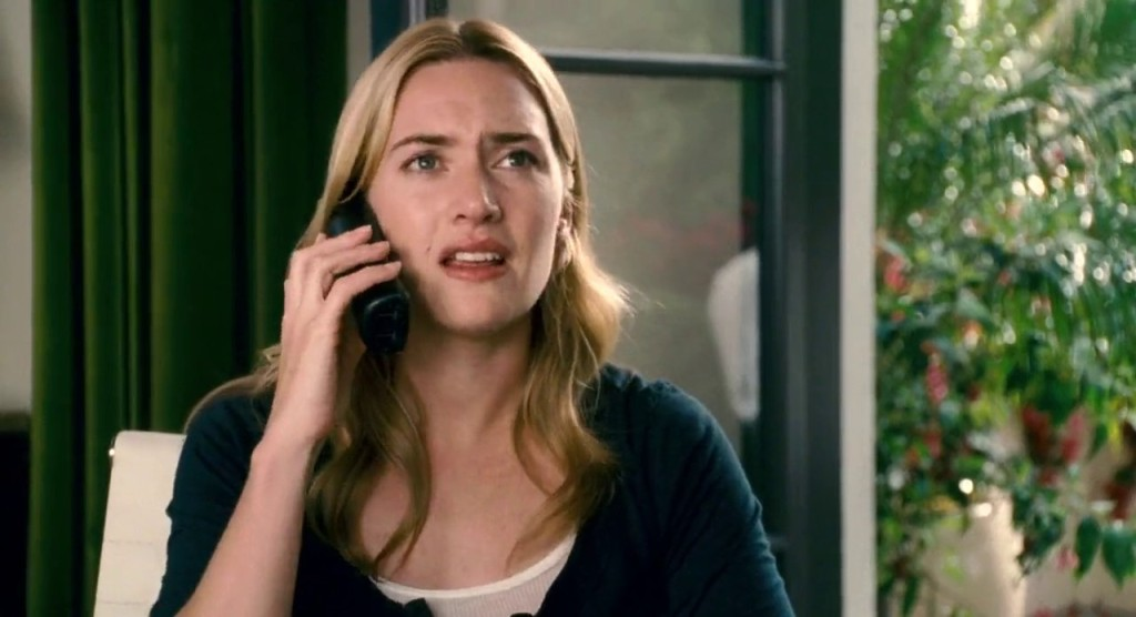 Iris (Kate Winslet) on the phone.