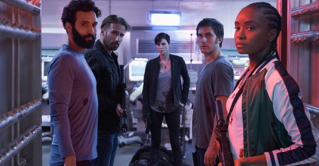 Joe (Marwan Kenzari), Booker (Matthias Schoenaerts), Andy (Charlize Theron), Nicky (Luca Marinelli) and Nile (KiKi Layne), all looking towards the camera.