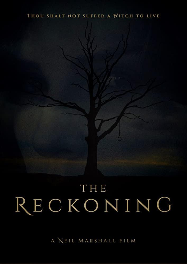 The film poster showing a leafless tree silhouetted against the night sky, a rope can be seen hanging from it.