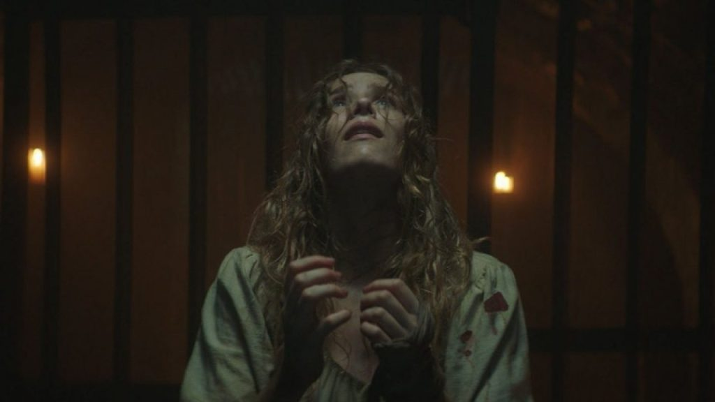 A dishevelled Grace (Charlotte Kirk) looking towards heaven.