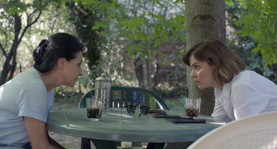 Adult Nana (Ketevan Gegeshidze) and Irina (Nino Kasradze) looking at each other.