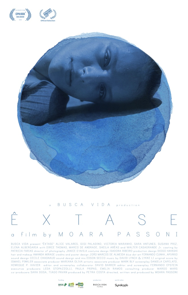 The film poster showing a young woman (Victoria Maranho) laying sideways on the floor. Only her head can be seen in a circular blue cutout over a white background.