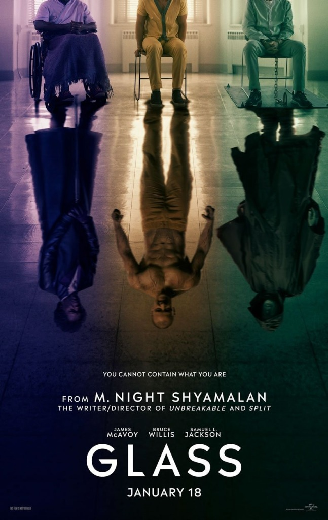 The film poster showing Elijah Price (Samuel L. Jackson), Kevin Crumb (James McAvoy) and David Dunn (Bruce Willis). They are sitting next to each other, but their reflections on the floor are standing tall, looking like villains.