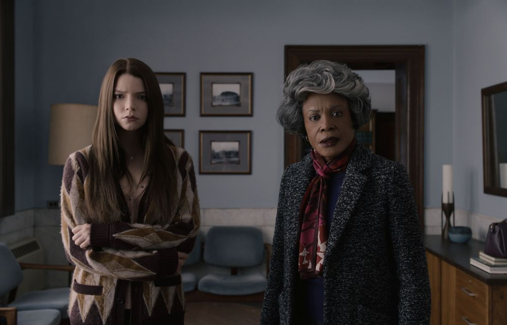 Casey (Anya Taylor-Joy) and Mrs Price (Charlayne Woodard) standing in an office.
