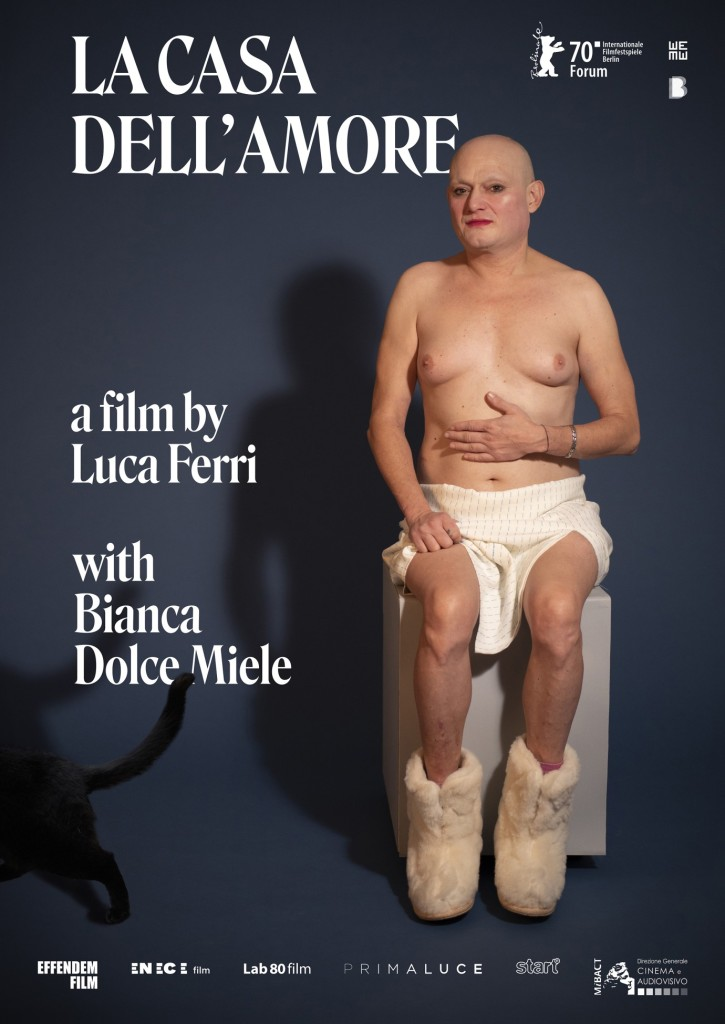 The film poster showing Bianca half-naked, sitting on a whie cube, wearing nothing but a white skirt and white furry boots. A black cat's but is also in the picture in the corner.