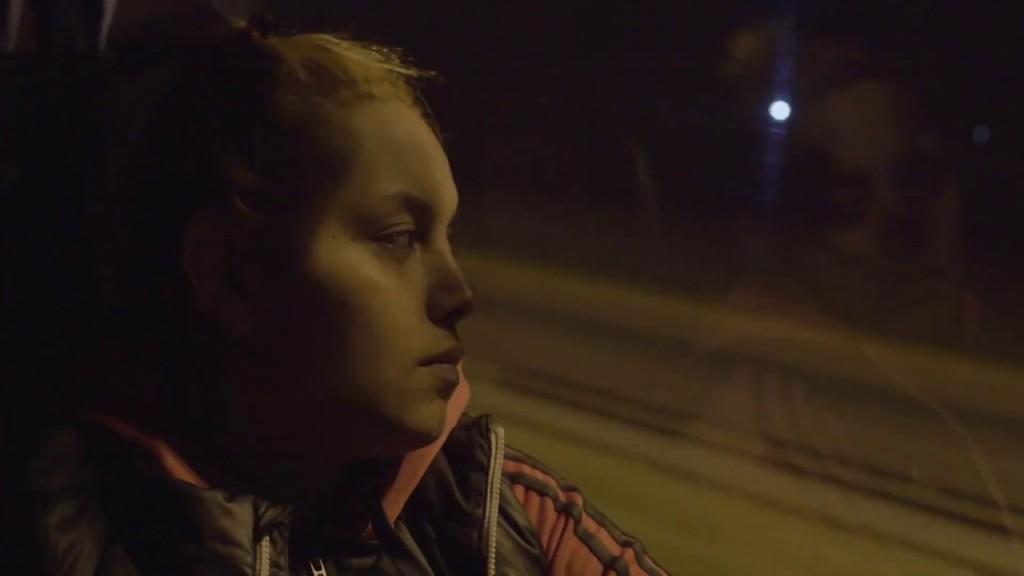 Barbara (Barbara Elisabeth Stanganelli) taking the bus at night.