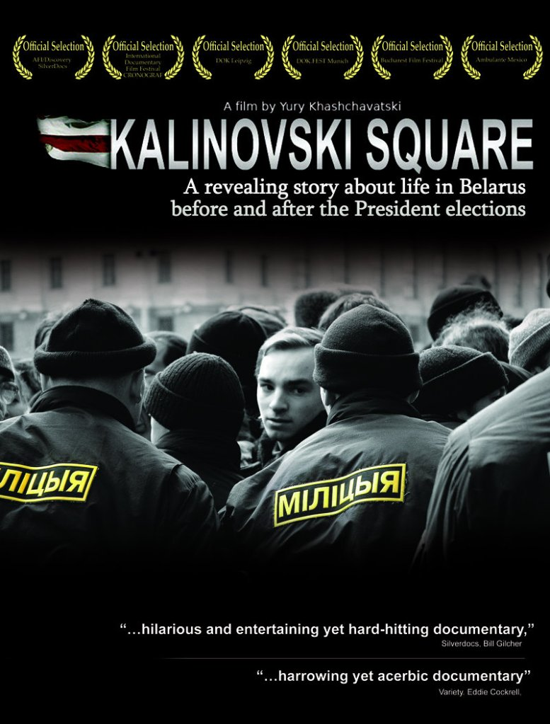 The film poster showing a young man in a crowd of people, surrounded by militia.