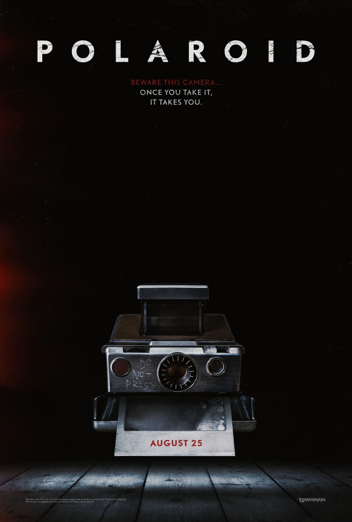 The film poster showing a polaroid camera lying on the floor, in the process of printing out a picture.