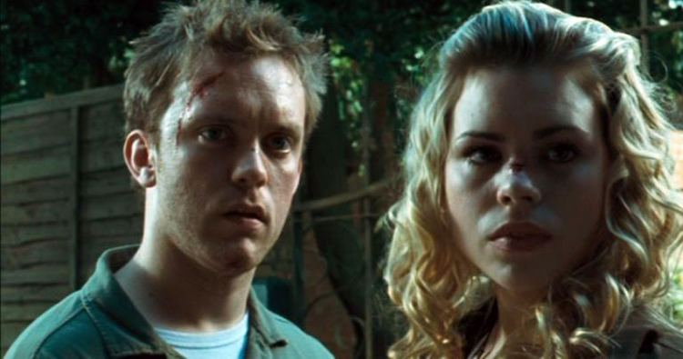 Tom (Luke Mably) and Jenny (Billie Piper) looking at something.