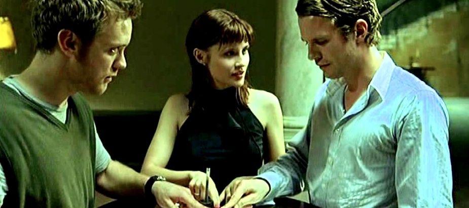 Tom (Luke Mably), Adele (Emma Catherwood) and Nick (Sam Troughton) using a planchette.