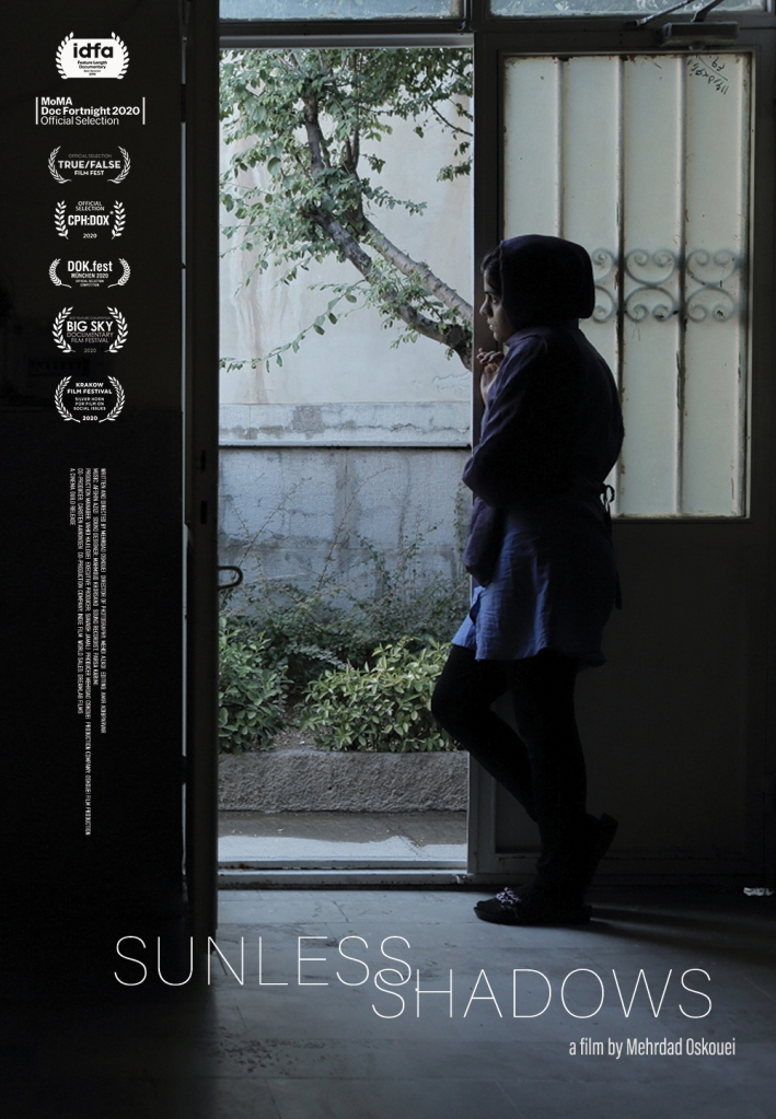 The film poster showing one of the incarcerated girls looking out the door of their cell.