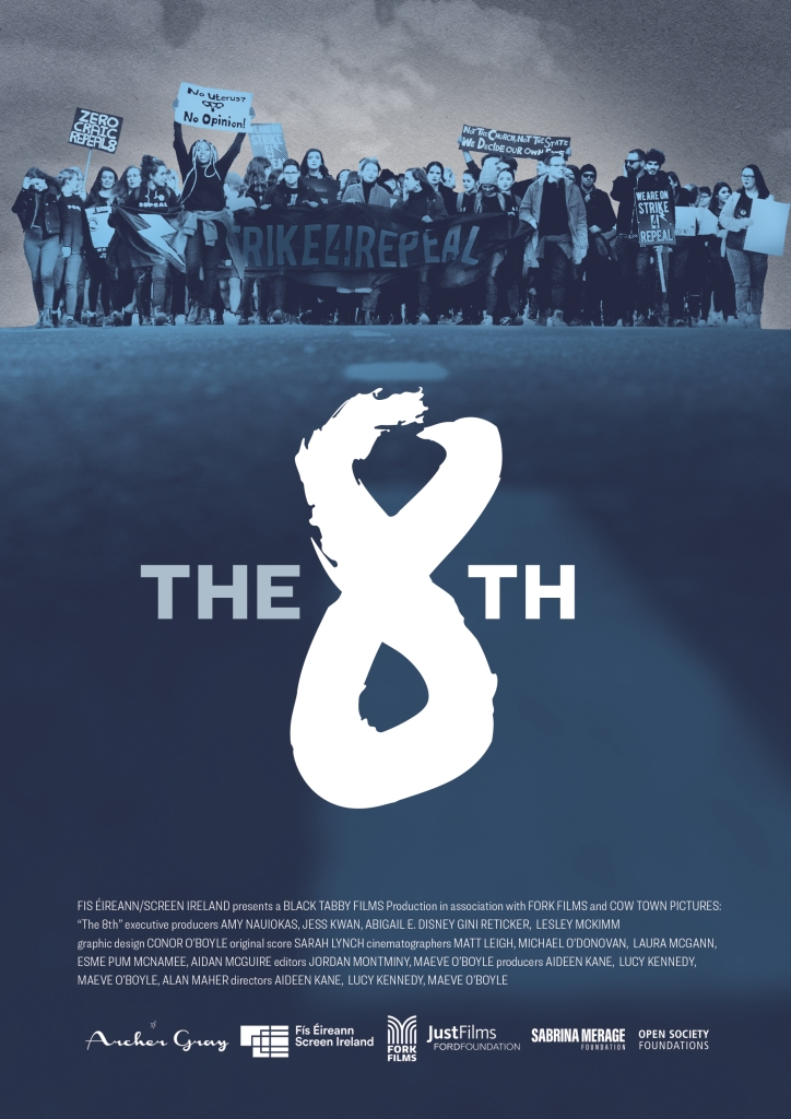 The film poster showing a group of protester above a large figure 8.