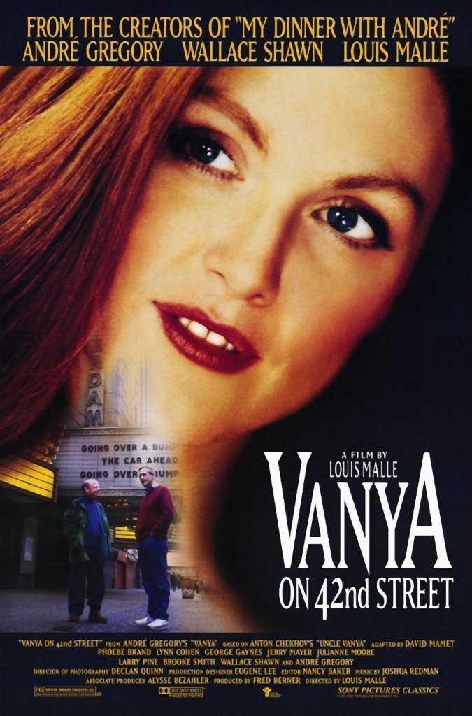 The film poster showing Yelena's (Julianne Moore) facen, and much smaller Vanya (Wallace Shawn) and Andre Gregory in front of the theater.