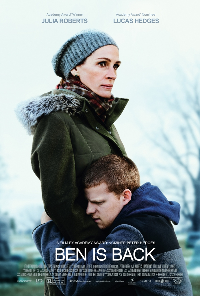 Ben (Lucas Hedges) kneeling in front of his mother Holly (Julia Roberts), hugging her tightly.