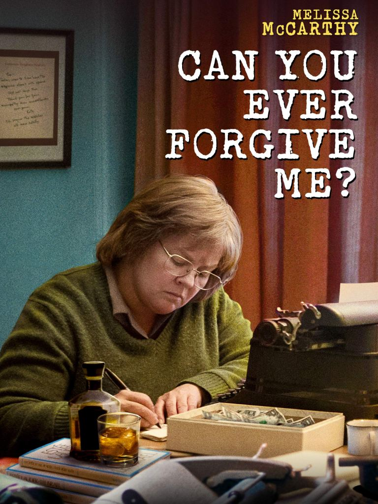 The film poster showing Lee Israel (Melissa McCarthy) writing something on a very fill desk, a glass of whiskey next to her.