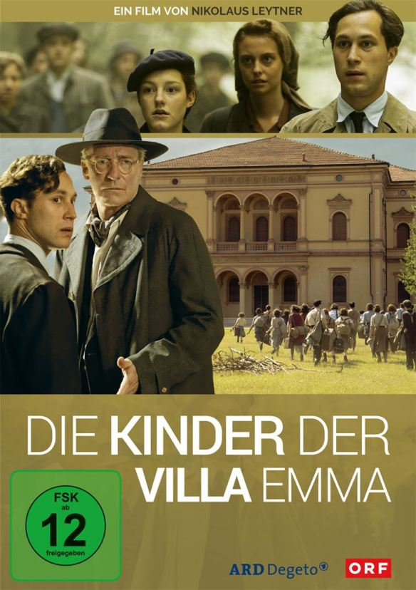 The film poster showing a group of children running towards a big mansion as well as several characters from the film.