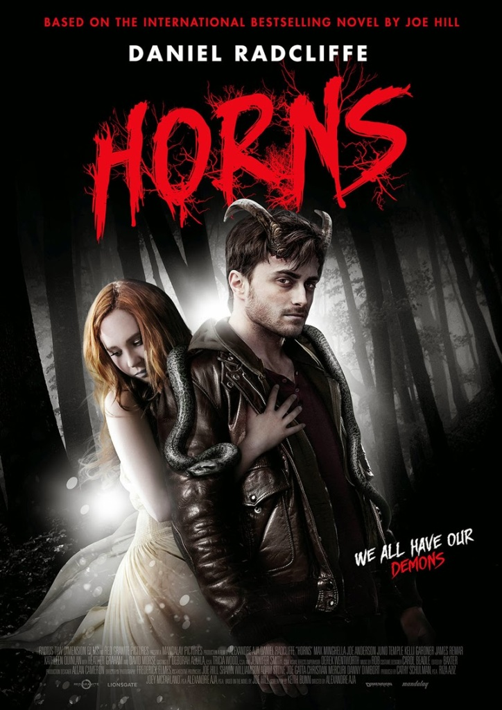 The film poster showing Ig (Daniel Radcliffe) with his horns and a snake over his shoulders. Merrin (Juno Temple is holding on to him from behind.