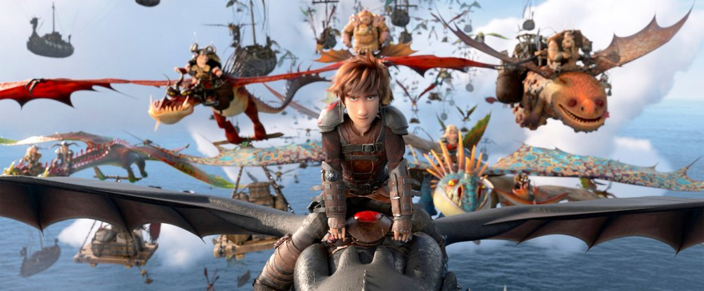 Hiccup (Jay Baruchel) riding Toothless as they lead a whole group of dragon and their riders.