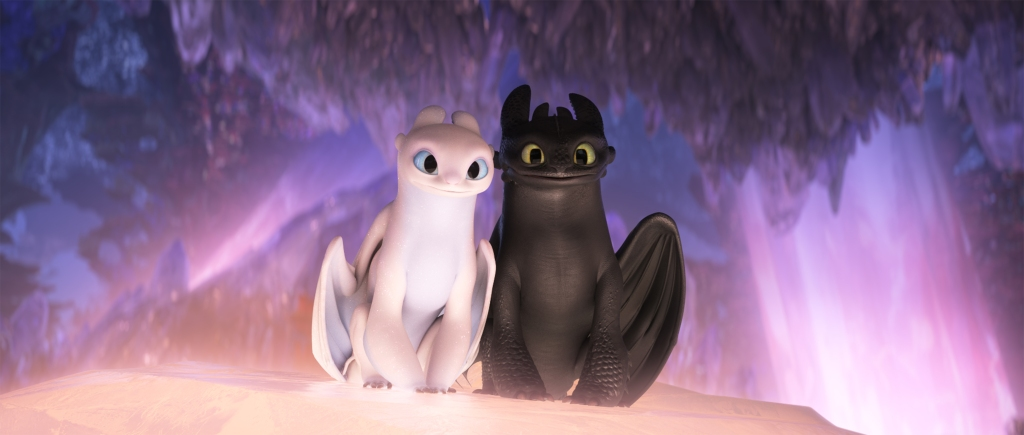 Light Fury and Toothless cuddled together.