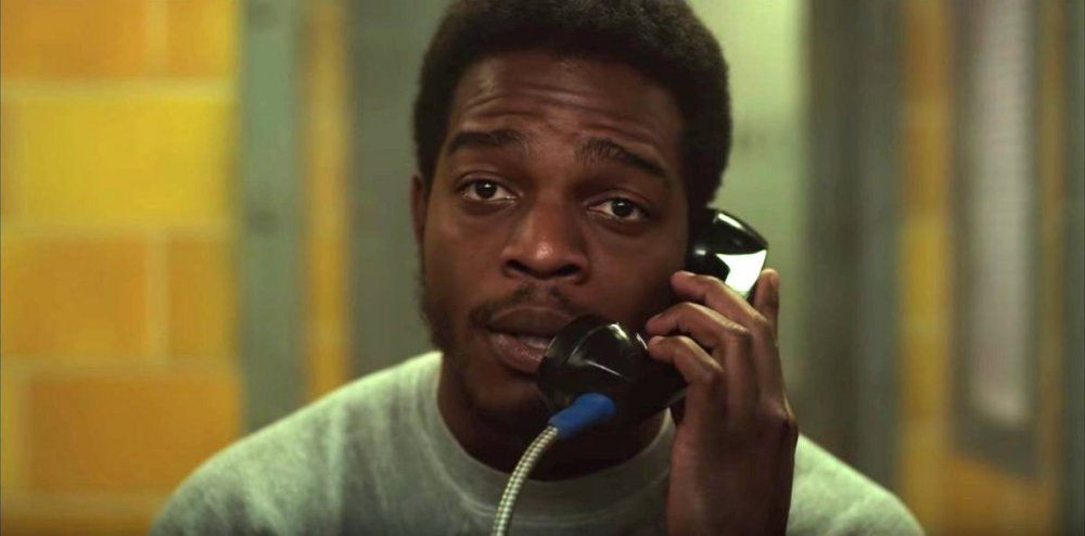 Fonny (Stephan James) talking on a prison visitor phone.