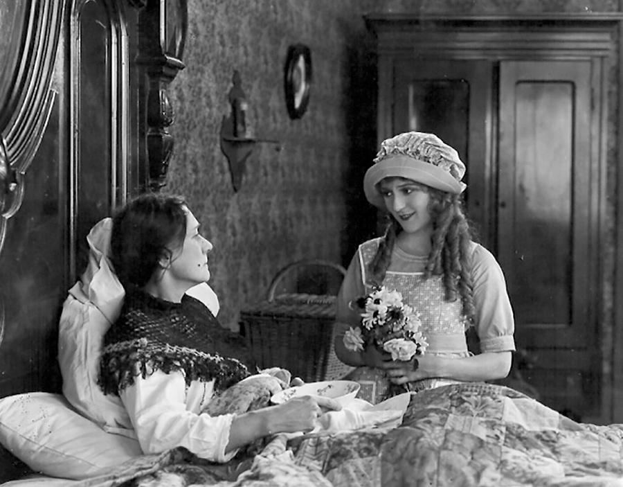 Pollyanna (Mary Pickford) visiting a sick woman.