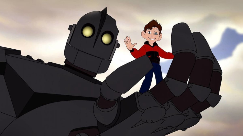 The Iron Giant giving Hogarth a ride in his hand.