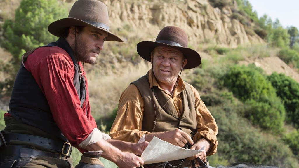Charlie (Joaquin Phoenix) and Eli Sisters (John C. Reilly) on horseback, studying a map.