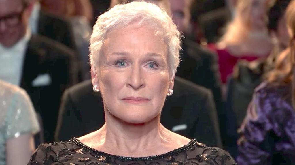 Joan (Glenn Close) sitting in the audience of the awards ceremony.