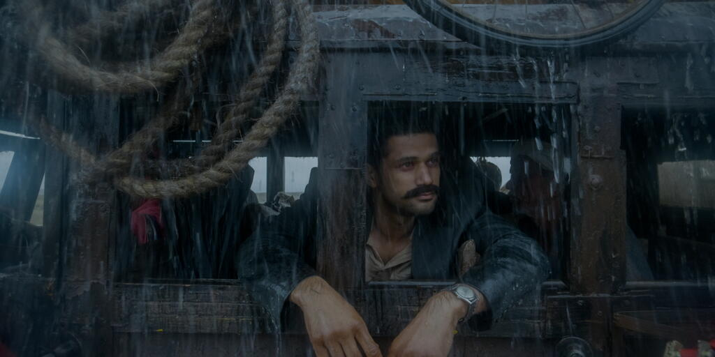 Vinayak (Sohum Shah) on a bus, looking out the window.