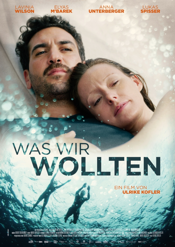 The film poster showing Alice (Lavinia Wilson) and Niklas (Elyas M'Barek) cuddled together and swimming in the sea.
