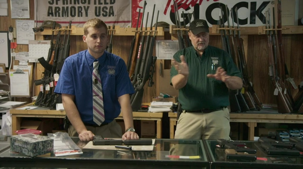 Two gunsellers in their shop.