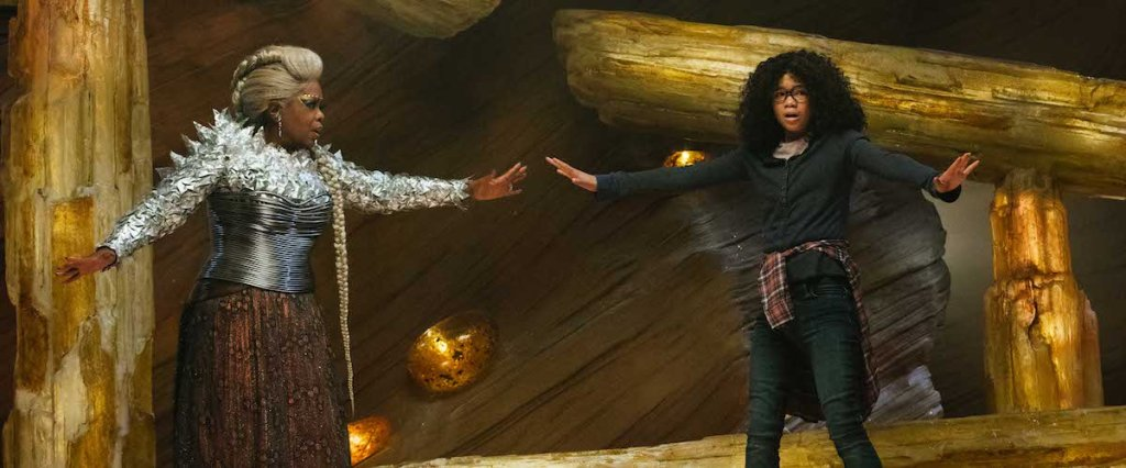 Meg (Storm Reid) reaching for Mrs Which (Oprah Winfrey) as she tries to balance on a stone.