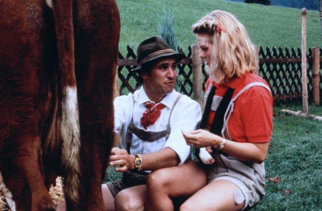 Joe (Tobias Morreti) showing Sabine (Sabine Cruso) how to milk a cow.