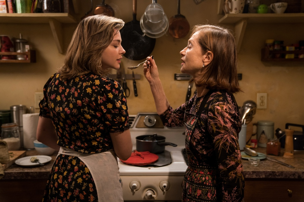 Frances (Chloë Grace Moretz) cooking with Greta (Isabelle Huppert).