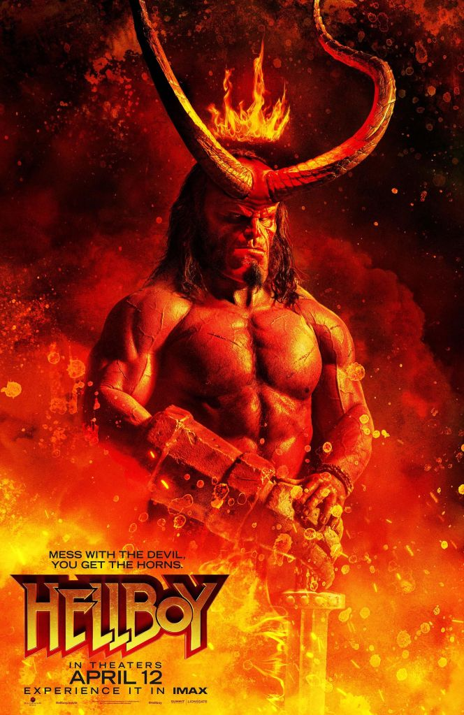 The film poster showing Hellboy (David Harbour) in full-horned glory standing in flames, holding a sword.