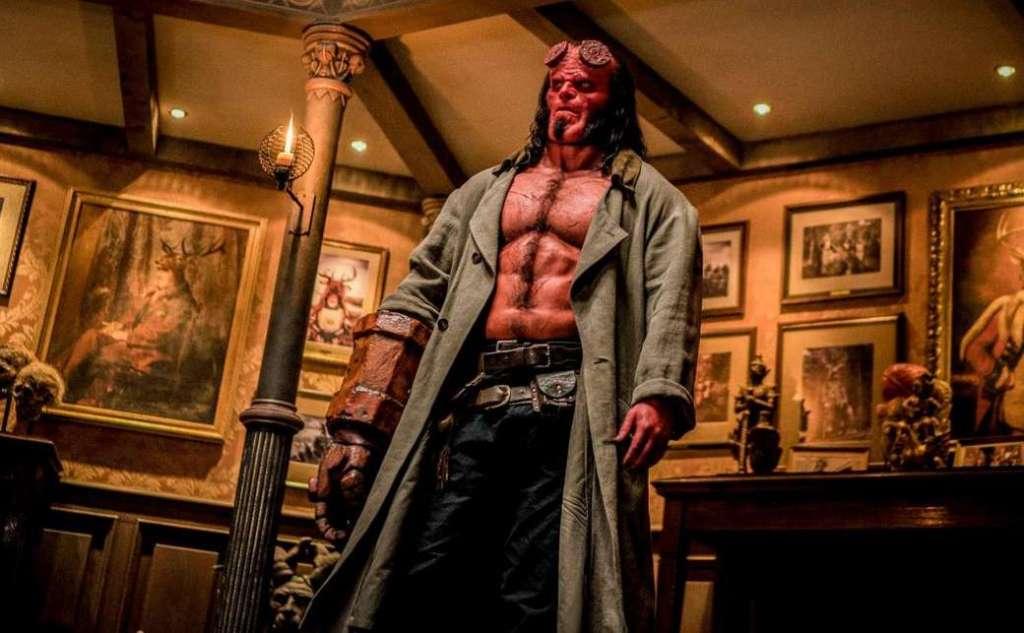 Hellboy (David Harbour) standing in a fancy room.