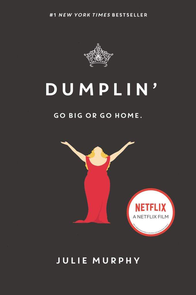 the book cover showing a fat girl in a fancy, red dress with her arms spread wide.