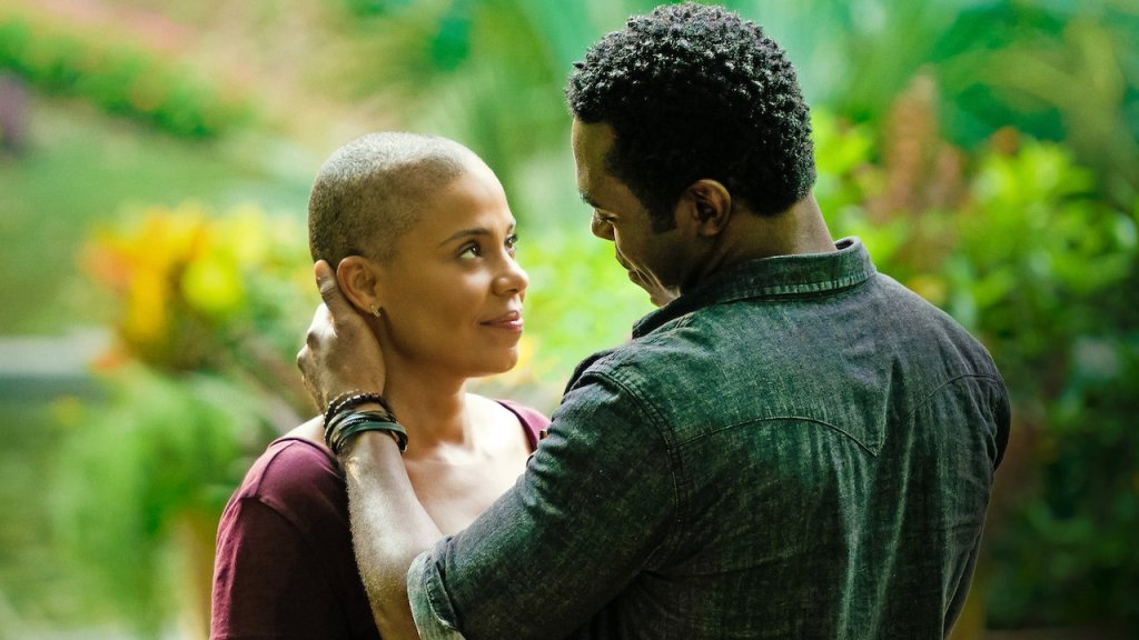 Violet (Sanaa Lathan) and Will (Lyriq Bent) holding each other.