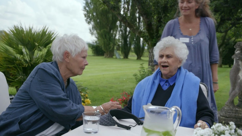 Judi Dench leaning towards Joan Plowright.
