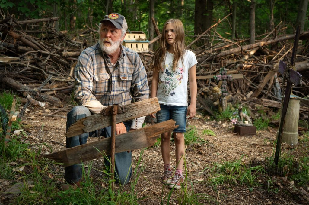Ellie (Jeté Laurence) and Jud (John Lithgow) in the pet cemetery.