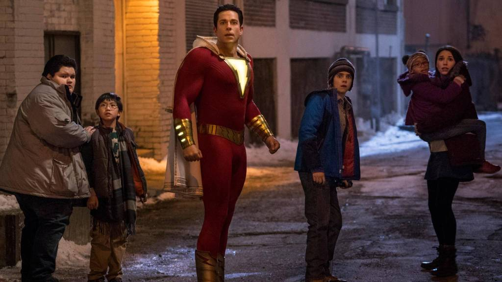 Shazam (Zachary Levi) with his foster siblings in the street.