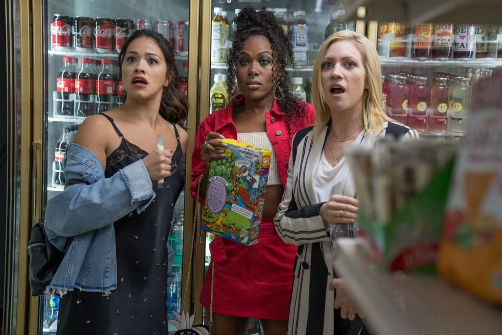 Jenny (Gina Rodriguez), Erin (DeWanda Wise) and Blair (Brittany Snow) in a grocery story, all with a shocked experession.