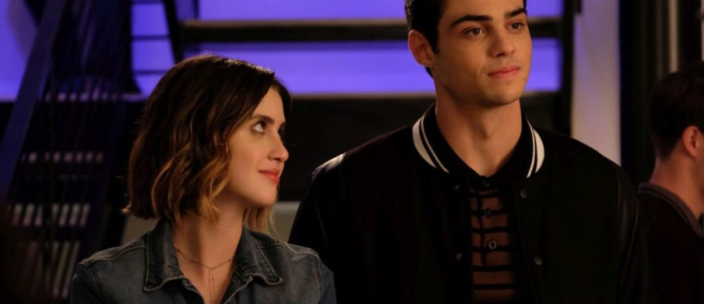 Celia (Laura Marano) looking at Brooks (Noah Centineo) with a smile.