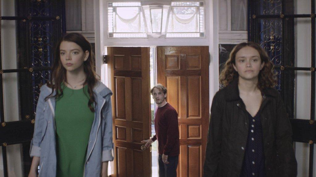 Lily (Anya Taylor-Joy) and Amanda (Olivia Cooke) showing Tim (Anton Yelchin) into Lily's house.