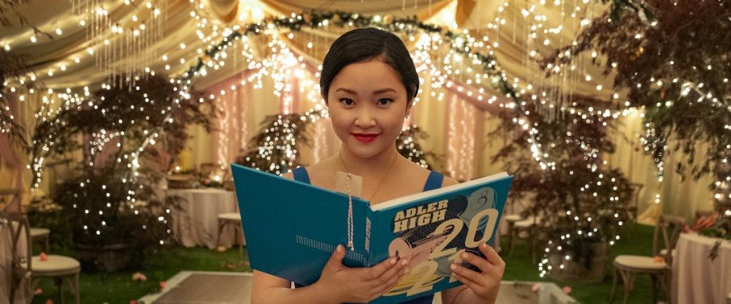 Lara Jean (Lana Condor) reading in her high school year book.