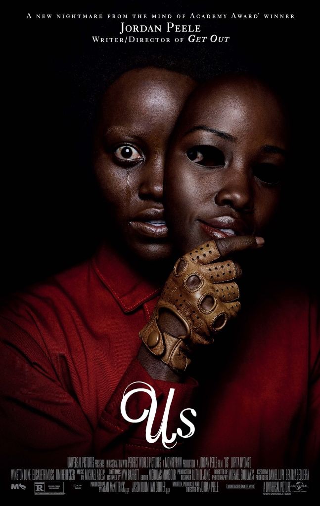 The film poster showing Adelaid/Red (Lupita Nyong'o) with horrified eyes, tears streaking down her face, holding a mask of her own smiling face.
