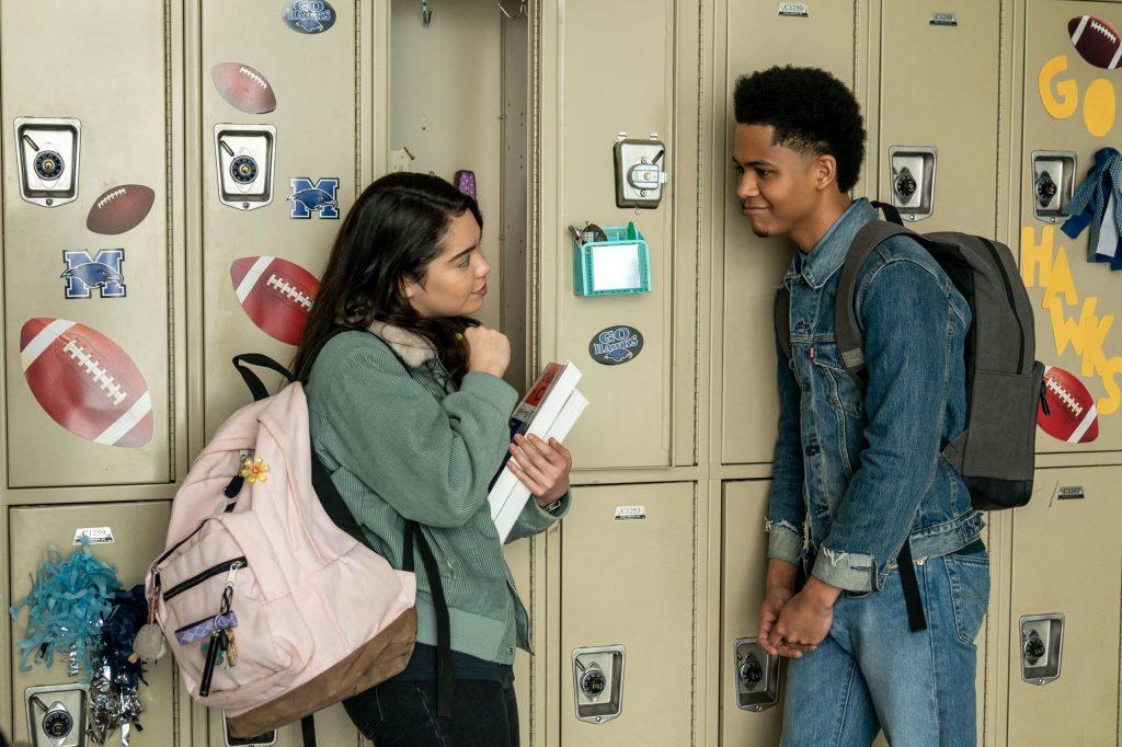 Amber (Auli'i Cravalho) talking to Ty (Rhenzy Feliz) in school.