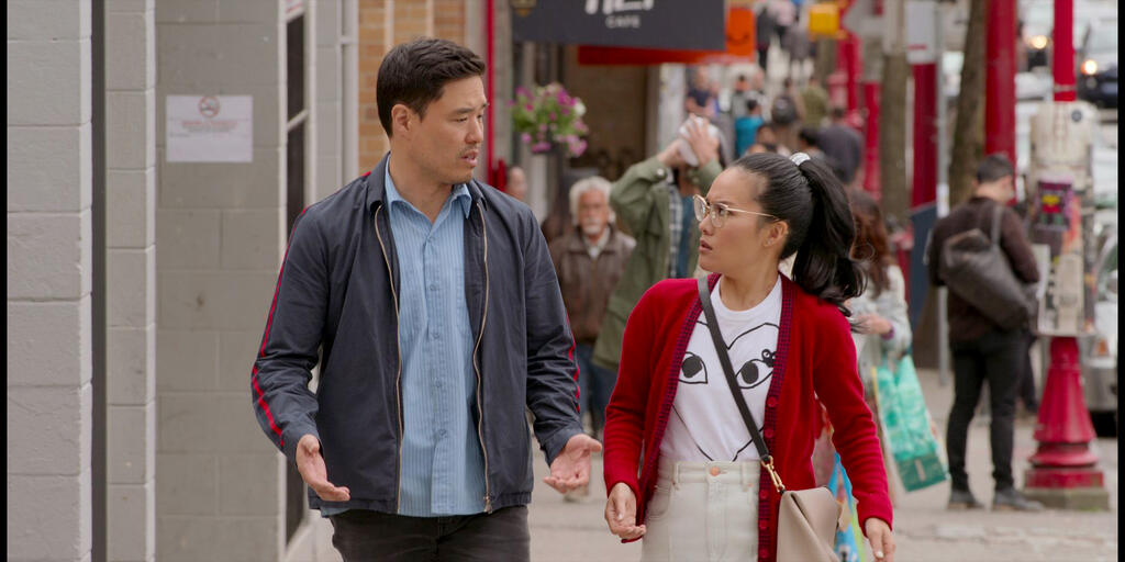 Marcus (Randall Park) and Sasha (Ali Wong) walking down a street, deep in discussion.