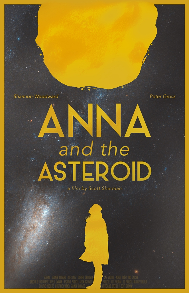 The film poster showing the silhouette of a woman in yellow on a black background. She is looking up at a big yellow asteroid above her.