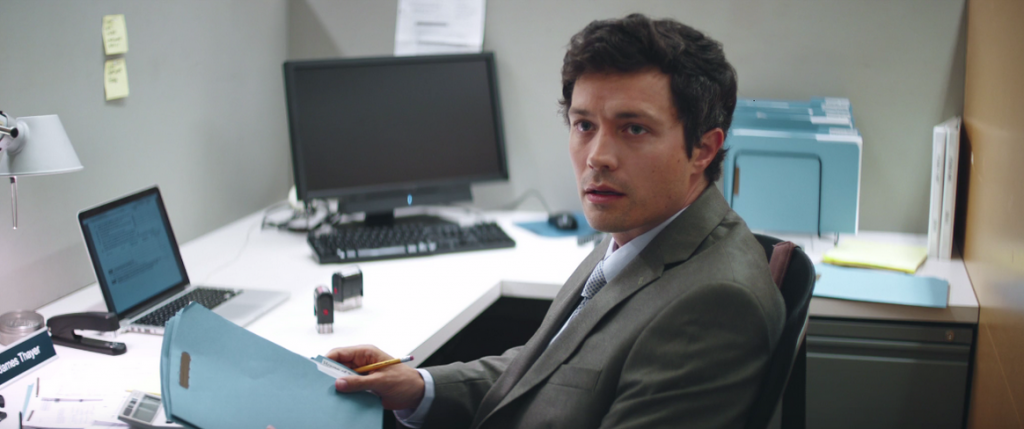 James (Christian Coulson) in his office.
